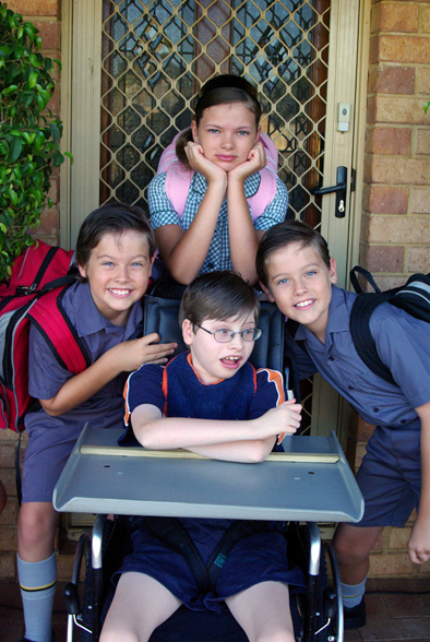 "First day of School 2009. Check out my big girl, a Yr 7 this year, trying to look ""not-too-excited"" like the boys! hee hee"